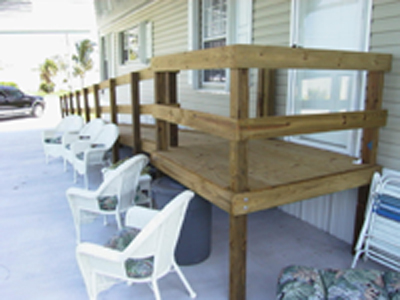 Custom wood ramp equipment to assist handicapped elderly for Ada mobile homes